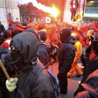 masked_squatters_demonstrate_in_the_centre_of_amst